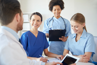 nurses listening to doctor