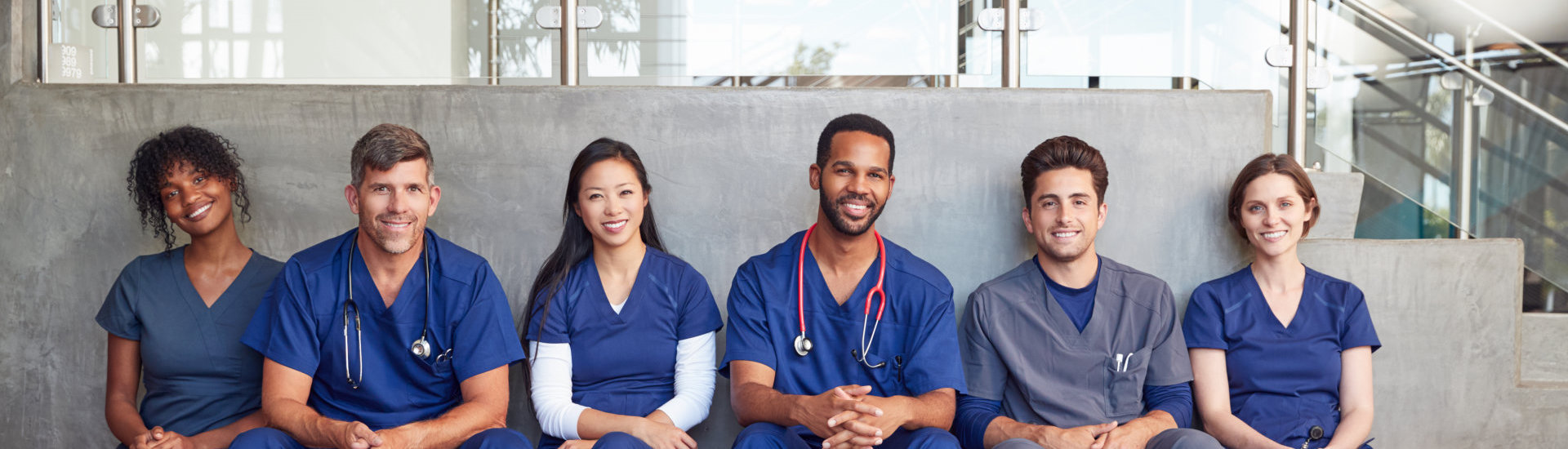 medical professionals sitting on the bench smiling