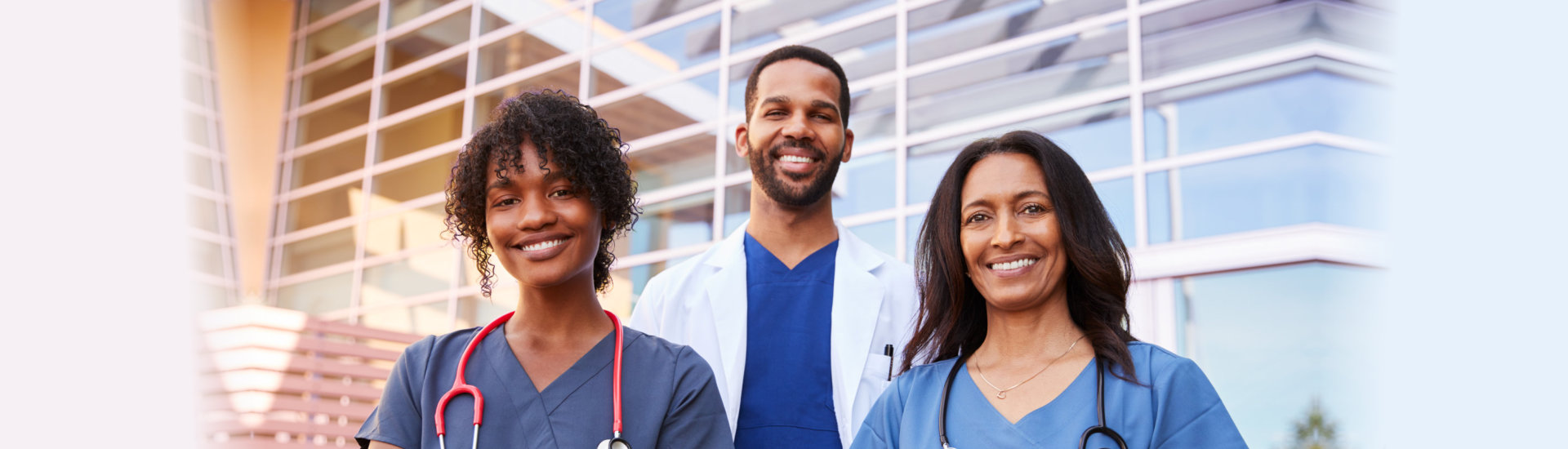 doctor and two nurses smiling