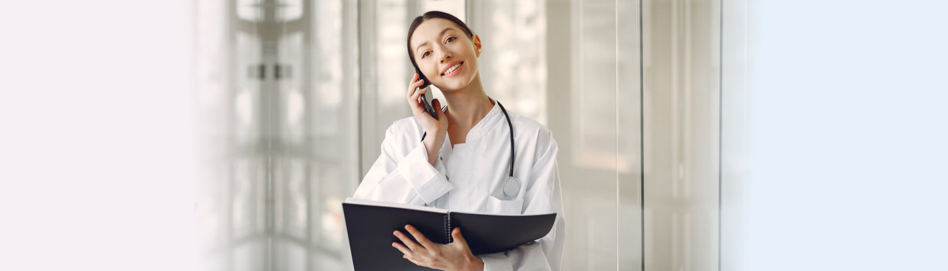 medical staff answering a phone call